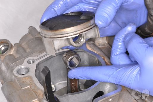 Change out the piston in the top end of the KX250F.