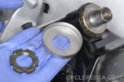 Remove the nut and cover to inspect the steering bearings on the XV 535 motorcycle.
