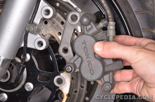 suzuki sv650 front brake caliper removal