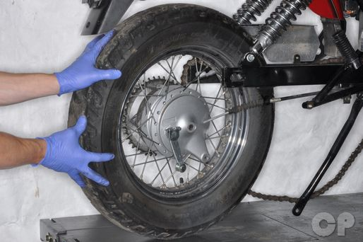 Suzuki GZ250 service manual rear wheel installation