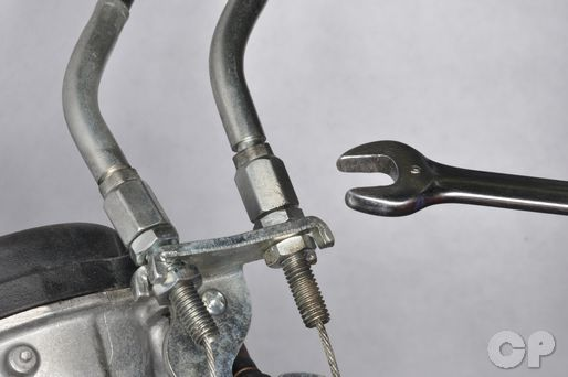 Suzuki GZ250 service manual throttle cable removal