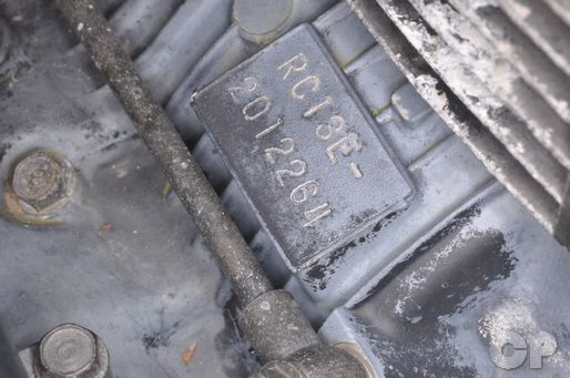 The engine identification number is stamped on the back of the engine case.