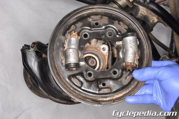 Clean your front drum brake panels on the TRX350D.