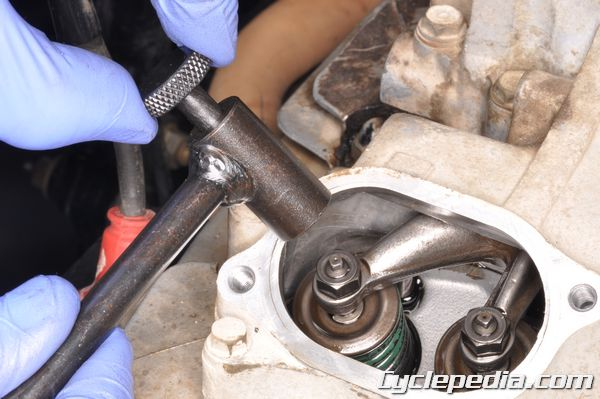 Adjust the valve clearance on your Honda TRX350 or TRX350D.