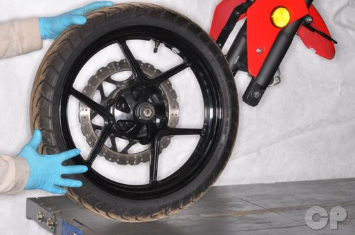 How to remove the front wheel on the Kawasaki EX250 ninja 250R.