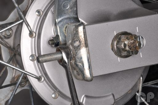 Adjust the drive chain slack on the Suzuki DRZ125 in the final drive chapter