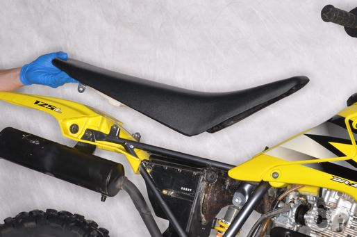 Remove the seat from the Suzuki DR-Z125 in the external components chapter
