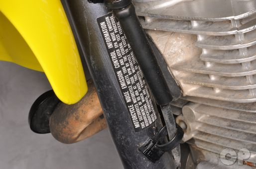 Find the DRZ-125L information label on frame in the quick reference chapter