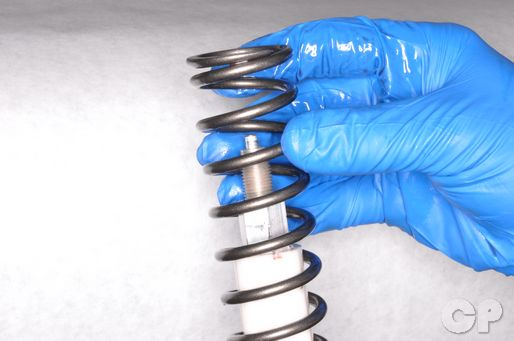 Remove the YZ125 front fork spring.