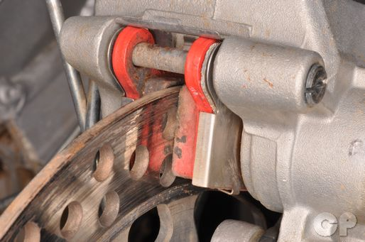 Replace the rear brake pads on the Yz125 if they do not meet the service limit