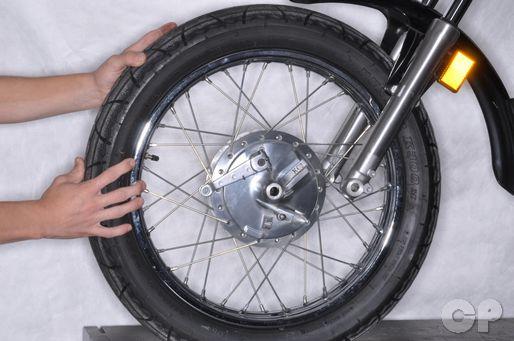 Honda CB250 Nighthawk front wheel removal installation.
