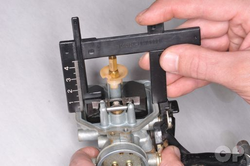 Inspect the CRF150F Carburetor Fuel Height with the fuel height gauge.