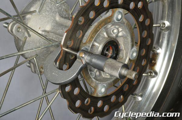 Kawasaki KLX140 rear brake disc inspection thickness runout replacement torque specs