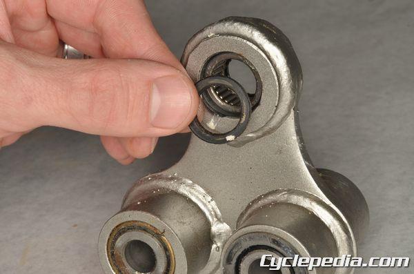 Kawasaki KLX140 rear suspension linkage bearing inspection lubrication shock absorber settings