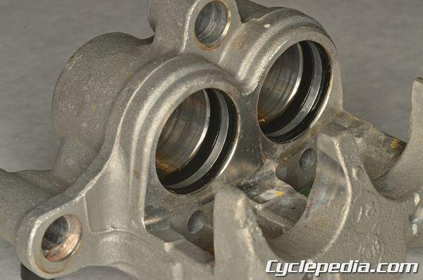 Kawasaki KLX140 brake caliper piston seals oil and dust seal replacement rebuild master cylinder