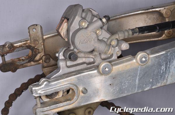 Suzuki DR350SE rear brake caliper brake pad replacment