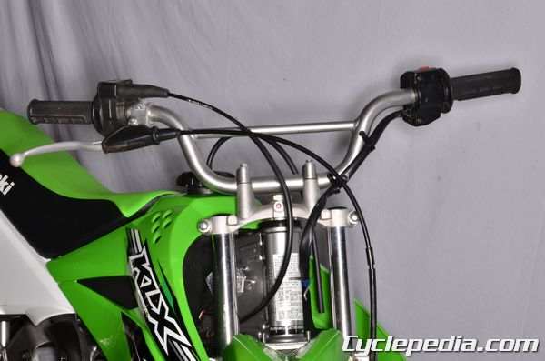 Kawasaki KLX110 handlebar torque spec steering head bearings and races