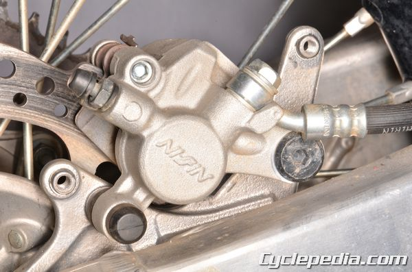 Kawasaki KX450F rear brake caliper pads rotor fluid bleeding