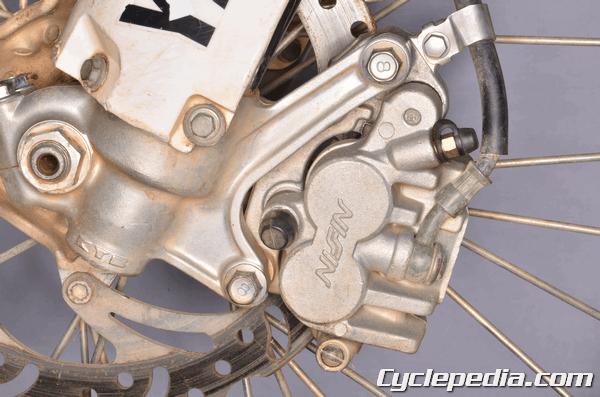 Yamaha YZ450F 2006-2009 front brake caliper rebuild pad service